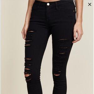 Frame black distressed skinny jeans